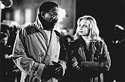 Morgan Freeman sleep-walks, while Monica Potter imitates Julia Roberts in Along Came a Spider.