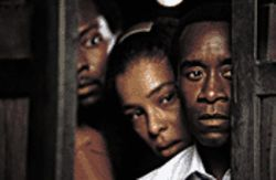 Blood bath: From left, Antonio David Lyons, Sophie Okonedo and Don Cheadle watch the unspeakable horror in Hotel Rwanda.