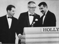 Lee Mendelson, left, Charles Schulz, and Bill Melendez accept the Emmy for Best Network Animated Special in 1966, for A Charlie Brown Christmas.