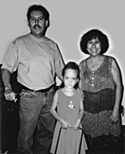Lenny Aviles with his daughter and mom, shortly before 