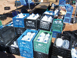 Water bottles ready for reuse on a ranch near Byrd Camp.