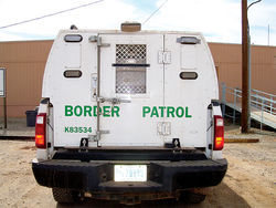 A Border Patrol vehicle parked at a facility the agency shares with the Tohono O'odham Police Department. On the reservation, the Border Patrol is a ubiquitous presence.