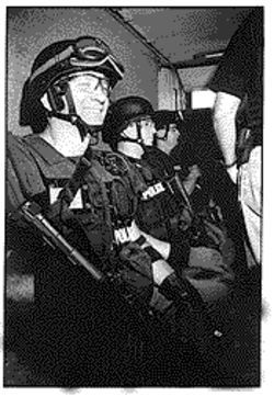 SAU officers Jerry Kilgore (on end of row) was shot a few years ago by a suspect in a probation case. He was back on the job two months later.