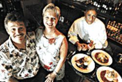 Almost all smiles: From left, co-owners Robert Capozzoli and Kristine Black, and head chef Vincent Contreras.