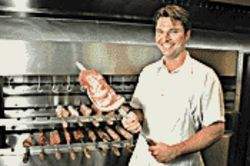 A man and his meat: Preparer Alessandro Moreli skewers a hunk o&#039;cow.