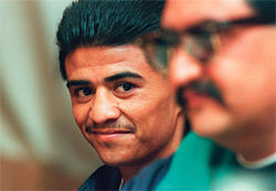 Michael Carbajal peeks over at brother Danny during a 2006 press conference in New York.