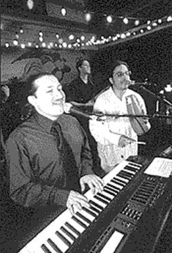 Raul Yáñez, left, is CPR's keyboardist and bandleader.
