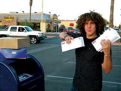 Tony Valdovinos, a student organizer, mailing back committment cards to the Latino families who filled them pledging to vote.