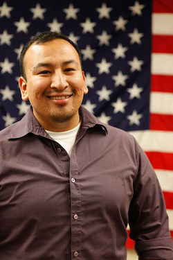 Joseph Larios organized stuents to urge west Phoenix residents to vote.