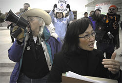 Down by Lawless: The activist (left) and fellow anti-immigrationist Yeh Ling-Ling (right) join forces at the Sandra Day O'Connor U.S. Courthouse for the January 13 Freedom Riders protest.