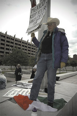 Make her day: Lawless channels Dirty Harry while using a Mexican flag as a doormat during the Freedom Riders event.