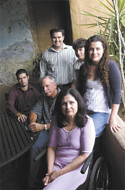 Pat and Karen Dains (surrounded by four of their children) own and operate Ajo Al&#039;s. They beat the rap from County Attorney Andrew Thomas, but are now considering a suit against him.