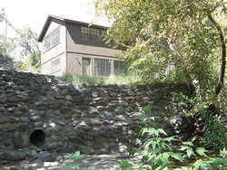 Larry Wade's cabin and the retaining wall that needed repair.
