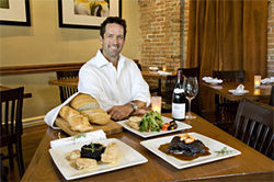 Caffe Boa owner Jay Wisniewski shows off the poularde (left), short ribs, and Capriatta plate.