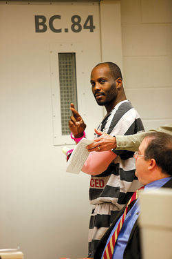 DMX gestures on his way to jail in December.