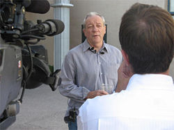 New Times co-founder Michael Lacey is interviewed by a local television crew after charges against him and co-founder Jim Larkin were dismissed.