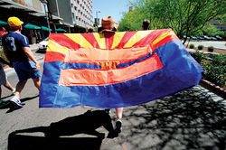 A demonstrator carries an equality flag during a recent march in Phoenix.