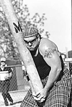 Scot put: A competitor at the Highland Games grabs his wood.