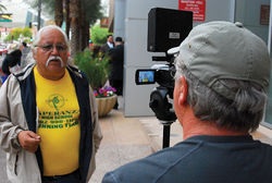 Gilman interviews activist Sal Reza at a protest in downtown Phoenix.