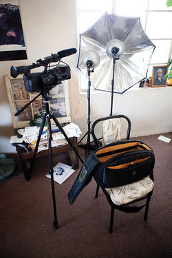 His tools of the trade — camera, tripod, and editing equipment