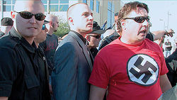 Neo-Nazis march to the U.S. District Court building in Phoenix.