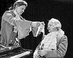Salieri (Richard Gilliland) shows Mozart (Ben Britain) the only way to see this production of Amadeus – masked.