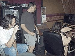 From left, Peacemakers Danny White, P.H. Naffah  and Roger Clyne, in the studio.
