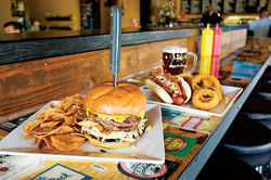 American eats, like hefty burgers and jumbo dogs, can be accompanied by a massive selection of brews.