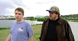 Michael Moore (right) chats with Mark Taylor, a survivor of the Columbine High School shooting, in Bowling for Columbine.