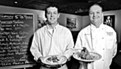 The platters, they matter: General manager Nate Hopper (left) and executive chef Bill Leisses bearing some tasty Southwestern fare.
