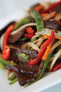 "Loving Hut's Mongolian beef dish makes brilliant use of soy-based ""meat."""