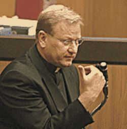 Monsignor Dale Fushek testifying in then-bishop  Thomas O'Brien's hit-and-run trial.