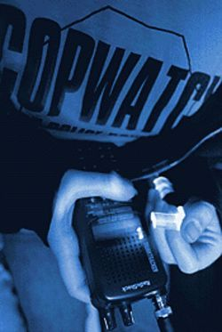 A Copwatch volunteer monitors a police scanner.