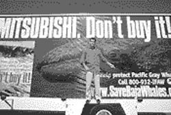 Actor Pierce Brosnan stands on a mobile billboard promoting the International Fund for Animal Welfare campaign.