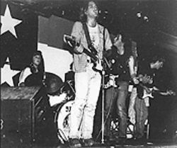 The Cuacha-era version of the Sidewinders, onstage at Club Congress during Christmas '87.