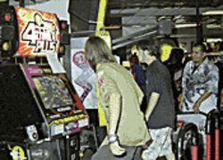 "Feuchtinger and friend at an earlier ""mix"" DDR machine  -- one of three versions at Golfland."