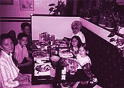 Blake, left; Raymond, next to her; and Venessa, across from her mother; at a Phoenix restaurant shortly before the fire.