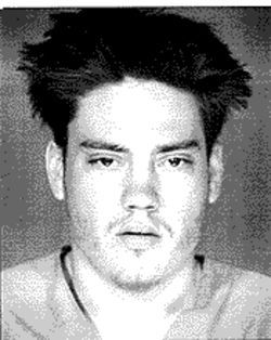 Justin Gregg, in a police booking photo taken in July 2001.