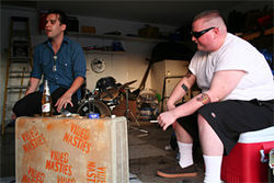 Welcome to east Mesa: Danny (left) and Travis in the garage.