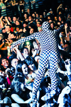 Of Montreal's artistic director David Barnes goes crowd-surfing during a show.