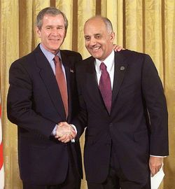 President George W. Bush and Carmona during his years as U.S. surgeon general.
