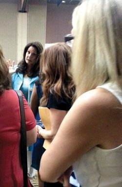 "Lynda Carter, who played Wonder Woman on TV, speaks with young women at the same fundraiser, where she referred to Carmona as a ""real hero."""