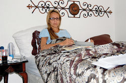 Bertha Oropeza rests at her Phoenix home the day after being released from the hospital.