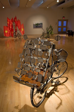 Foreground: I am Large. I contain Multitudes (2009) by Dinh Q. L&amp;ecirc;. Background: The Infrastructure of Nationalism (2009) by Dinh Q. L&amp;ecirc;.