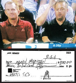 Above: The shot of Jack Hegarty (left) and Tim Mason at a D-backs game that sparked the investigation. Behind Hegarty is Karen Rasmussen of the Arizona Trucking Association. Below: Hegarty's check for the tickets wasn't cashed until after he was told he'd be investigated.