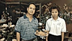 Super Dragon duo: chef/co-owner Ken Kwok (left) holding one of Lemons' faves, the walnut prawns; and his business partner, the ever-energetic Kam Li.