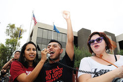 Undocumented student Hugo Sanchez (center), protesting outside Phoenix ICE offices; Sanchez, 22, was arrested with Cruz on March 20 in an act of civil disobedience outside Trevor G. Browne High School, in West Phoenix.