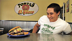 Look at the size of that thing:  Tortas El G&amp;uuml;ero owner Gustavo Lom eyes a Cubana.