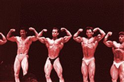 Rob Schuh, second from left, flexes his muscles at a 1989 bodybuilding contest in San Diego.