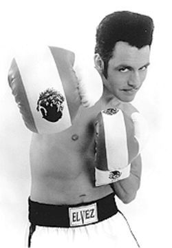 Coming at you: The split personality El Vez takes on his soul's struggle, with gloves.
